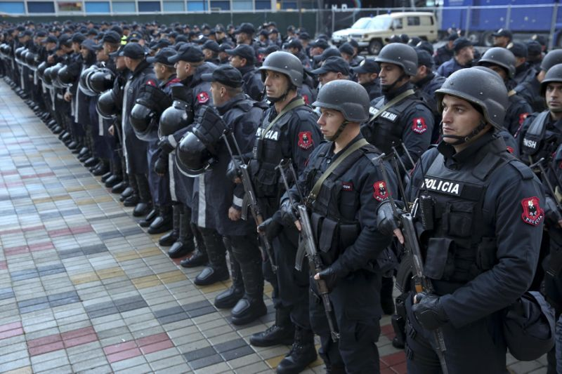 Albanian police lined up outside the Elbasan stadium ahead of the Albania-Israel football match.