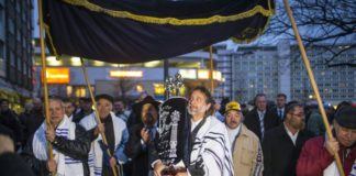 A member of the Jewish community carries Torah scrolls during the dedication service of the new synagogue in the former church in Cottbus.